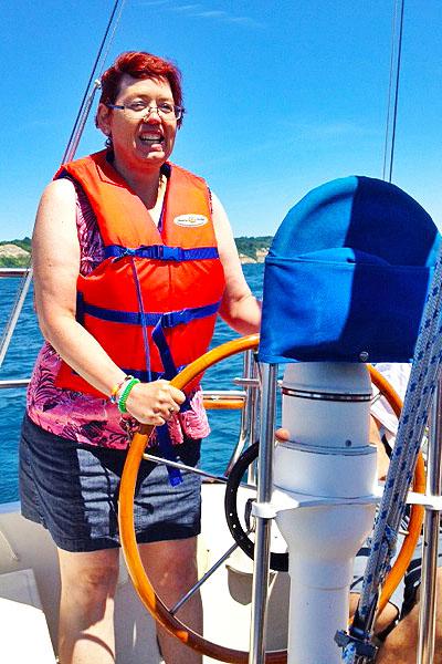 Woman sailing a boat