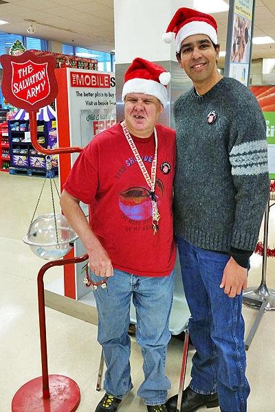 Two man in santa hats
