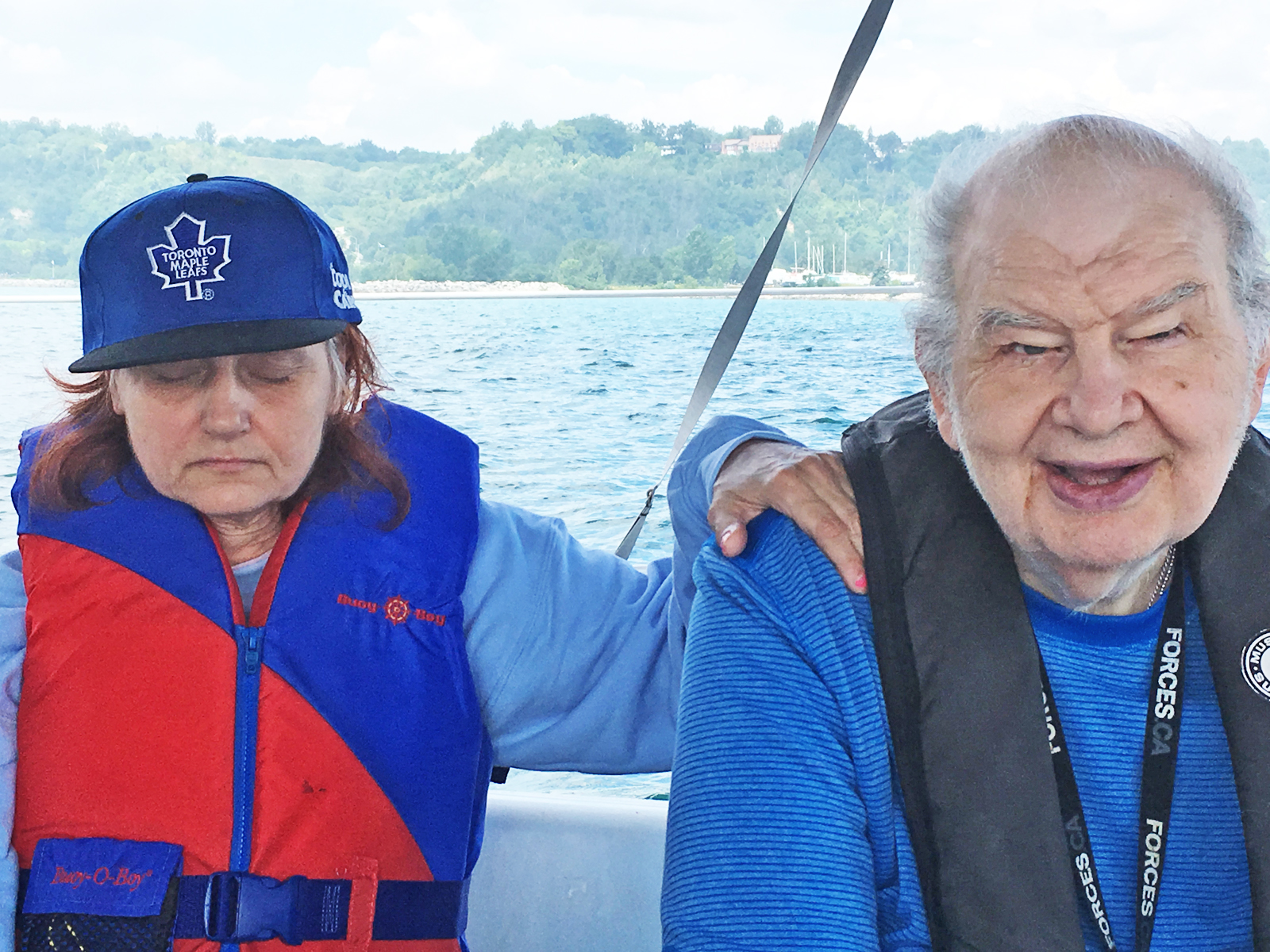 Two residents on the boat enjoying sailing