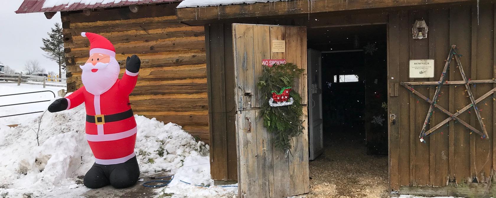 inflatable santa welcomes guests at the barn